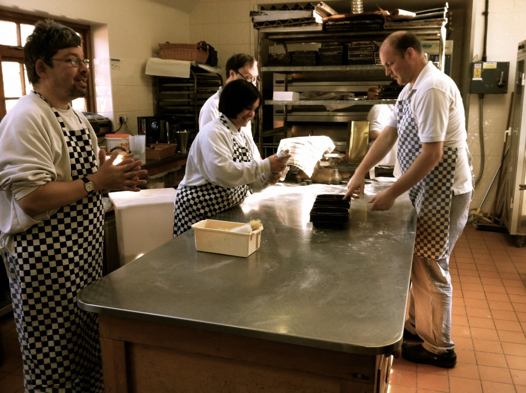 Raana (left, centre) and her fellow bakers hard at work in the Lantern Bakery