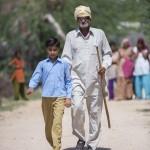 Shankari being led by his grandaughter.